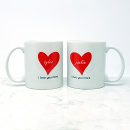 "Say ""I love you more"" with these personalized couples mugs in a set of 2"